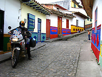 Going through the ¨Calle de los Recuerdos¨ in Guatape, Antioquia, Colombia. May 1, 2008..Born in Argentina, photographer Ivan Pisarenko in 2005  decided to ride his motorcycle across the American continent. While traveling Ivan is gathering an exceptional photographic document on the more diverse corners of the region. Archivolatino will publish several stories by this talented young photographer..Closer look at  Ivan's page www.americaendosruedas.com....