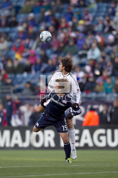 New England Revolution forward Zack Schilawski (15) and DC United defender Dejan Jakovic (5) battle for head ball. In a Major League Soccer (MLS) match, the New England Revolution defeated DC United, 2-1, at Gillette Stadium on March 26, 2011.
