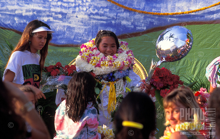 People giving & recieving leis on Lei day, May day