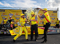 Sep 25, 2016; Madison, IL, USA; NHRA top fuel driver Shawn Langdon celebrates as a crew member is doused with Mello Yello soda after winning the Midwest Nationals at Gateway Motorsports Park. Mandatory Credit: Mark J. Rebilas-USA TODAY Sports