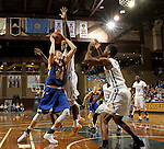 SIOUX FALLS, SD - NOVEMBER 26:  Mike Daum #24 from South Dakota State University eyes the basket past the defense of Hanner Mosquera-Perea #12 from East Tennessee State University during their game at the Sanford Pentagon Saturday evening in Sioux Falls. (Photo by Dave Eggen/Inertia)
