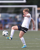 Portland Thorns FC defender Rachel Buehler (16) passes the ball.  In a National Women's Soccer League (NWSL) match, Boston Breakers (blue) defeated Portland Thorns FC (white/black), 2-1, at Dilboy Stadium on August 7, 2013.