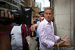 © Joel Goodman - 07973 332324 . 27/08/2016 . Manchester , UK . JEREMY KYLE and a film crew confront fundamentalist Christians who are picketing the annual Pride Parade through Manchester City Centre . The event is part of Manchester Gay Pride's Big Weekend . Photo credit : Joel Goodman
