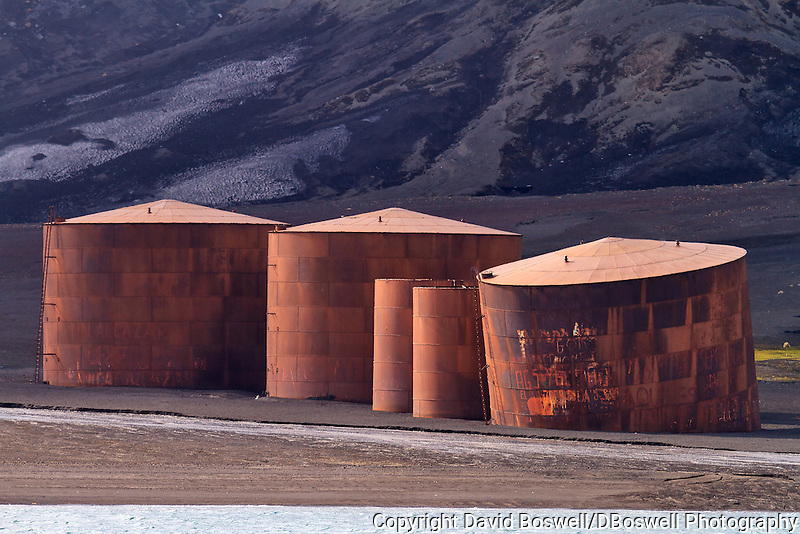 Rusting tanks are among some of the remnants of the bygone whaling era left at an abandoned Norwegian whaling base in Whalers Bay on Deception Island, in the South Shetland Islands near the Antarctic Peninsula.
