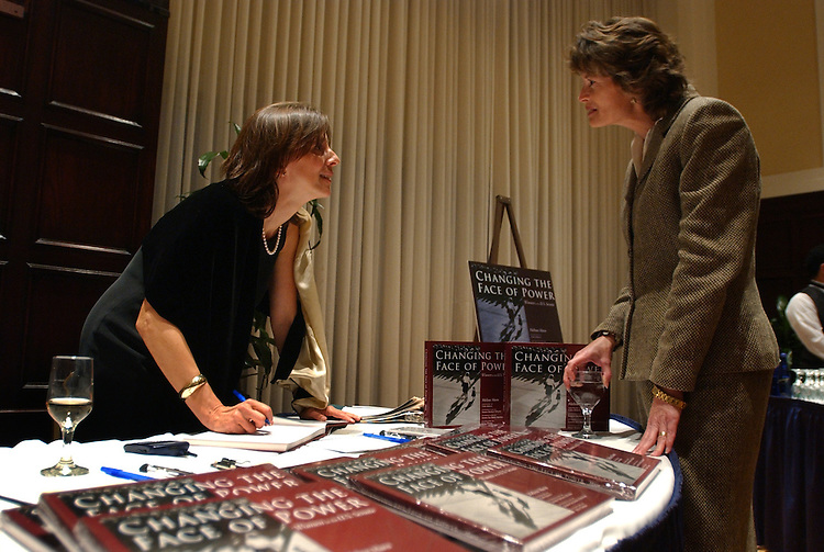 "Melina Mara, left, photographer for the Washington Post, chats with Sen. Lisa Murkowski, R-Alaska, at the opening of Mara's new book ""Changing the Face of Power: Women in the U.S. Senate.""  The book is published by the University of Texas Press, and the reception was held at the National Press Club."