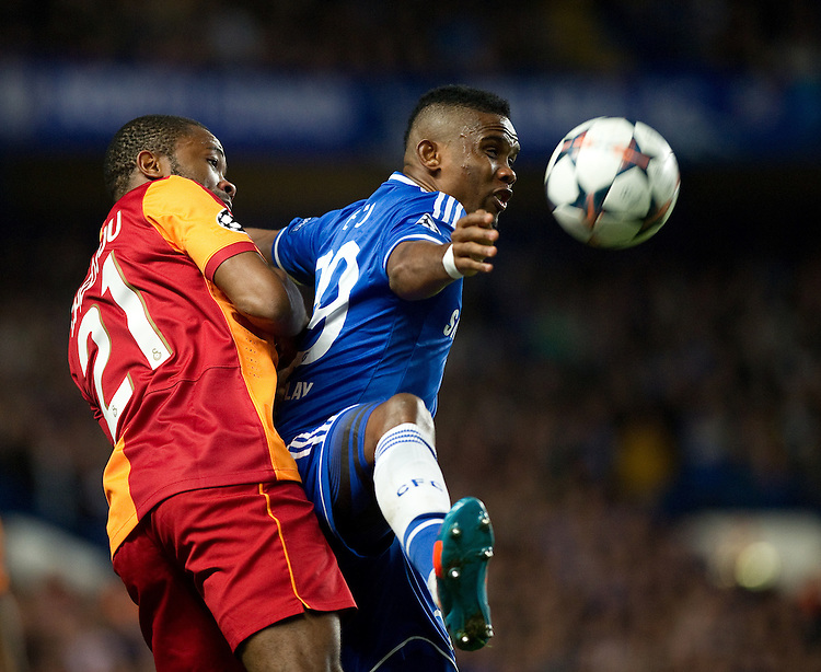 Chelsea's Samuel Eto'o holds off the challenge from Galatasaray's Aurelien Chedjou<br /> <br /> Photo by Ashley Western/CameraSport<br /> <br /> Football - UEFA Champions League First Knockout Round 2nd Leg - Chelsea v Galatasaray - Tuesday 18th March 2014 - Stamford Bridge - London<br />  <br /> &copy; CameraSport - 43 Linden Ave. Countesthorpe. Leicester. England. LE8 5PG - Tel: +44 (0) 116 277 4147 - admin@camerasport.com - www.camerasport.com