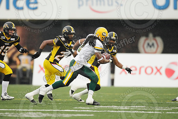 August 8, 2009; Hamilton, ON, CAN; Hamilton Tiger-Cats defensive back Sandy Beveridge (19), defensive back Chris Thompson (26) and defensive back Geoff Tisdale (9) chase Edmonton Eskimos slotback Fred Stamps (2). CFL football: Edmonton Eskimos vs. Hamilton Tiger-Cats at Ivor Wynne Stadium. The Tiger-Cats defeated the Eskimos 28-21. Mandatory Credit: Ron Scheffler. Copyright (c) 2009 Ron Scheffler.