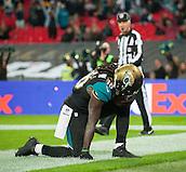 09.11.2014.  London, England.  NFL International Series. Jacksonville Jaguars versus Dallas Cowboys. Jaguars' Denard Robinson (#16) celebrates his touch down.