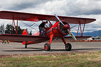 Red vintage biplane, Arlington Fly-In 2016, Washington State, USA.
