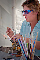 Glass astist, Katherine French, creates unique glass beads, donating the proceeds to'Beads of Courage Program' supporting children with serious illnesses, during the final weekend of the 54th  season of Art in the Park, hosted by the Naples Art Association at The von Liebig Art Center, Naples, Florida, USA, April 2, 2011. Photo by Debi Pittman Wilkey