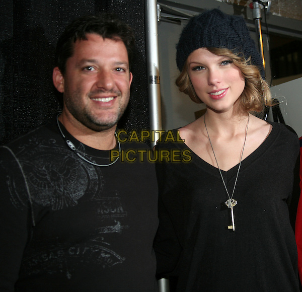 NASCAR's TONY STEWART & TAYLOR SWIFT.at Sprint Sound & Speed Presented by SunTrust held at Nashville Municipal Auditorium, Nashville, TN, USA, 9th January 2010..half  length black beanie hat silver key necklace .CAP/ADM/RR.©Randi Radcliff/Admedia/Capital Pictures