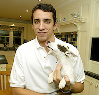 Sheffield born racing driver Justin Wilson pictured at family home in Sheffield with family dog Paris