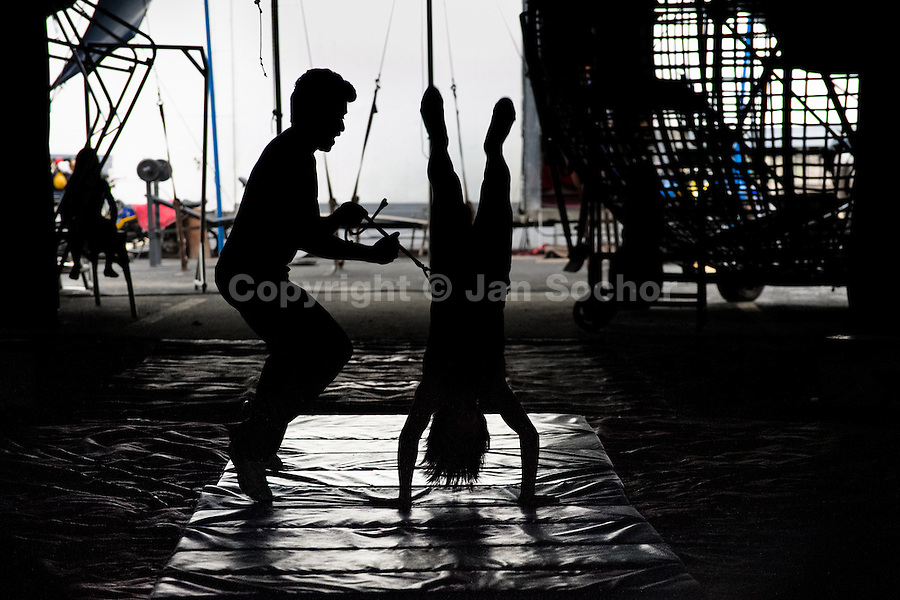 A young female acrobat, a member of the old circus family Fuentes Gasca from Mexico, performs a salto during the morning lessons in Circus Renato, in San Salvador, El Salvador, 7 May 2011.