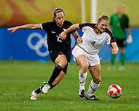 Emma Kete, Rachel Buehler. The USWNT defeated New Zealand, 4-0, during the 2008 Beijing Olympics in Shenyang, China.  With the win, the USWNT won group G and advanced to the semifinals.
