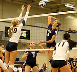 SIOUX FALLS, SD - SEPTEMBER 19:  Ashley Wilson #10 from Augustana looks for the block on Jordan Calef #3 from the University of Sioux Falls during their match Saturday afternoon at the Stewart Center. (Photo by Dave Eggen/Inertia)