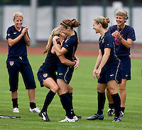 USWNT midfielder Heather O'Reilly is congratulated by teammate Heather Mitts after they won a game of hit the crossbar during practice at Beijing Normal University for the upcoming semi-final game against Japan in the 2008 Beijing Olympics in Beijing, China.