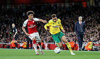 Josh Murphy of Norwich City battles Reiss Nelson of Arsenal during the Carabao Cup match between Arsenal and Norwich City at the Emirates Stadium, London, England on 24 October 2017. Photo by Carlton Myrie.