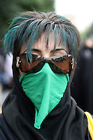 A young woman in Toopkhaneh Square with her hair dyed green, the colour of the opposition, and a green mask as a symbol of her silent protest. Following a disputed election result, thousands of supporters of opposition candidate Mir-Hossein Mousavi took to the streets in protest.