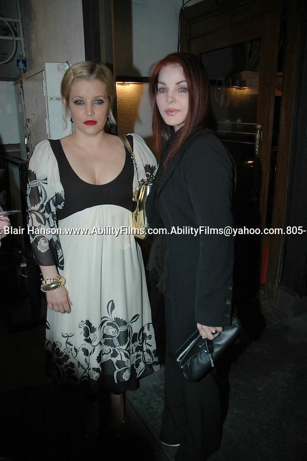 Exclusive- Lisa Marie Presley with family looking pregnant again. The family was eating dinner at  Mastro's restaurant in Beverly Hills on 5-19-07