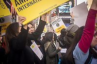 Members of Amnesty International on their supporters rally in Times Square in New York on Thursday, February 14, 2013 in support of the domestic and international Violence Against Women Act (VAWA). The domestic act would extend protection to immigrant, native american and LGBT victims while the international act would make ending violence against women a diplomatic priority for the United States.  (© Richard B. Levine)