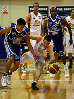 Arthur Trousdell tries to steal off Keith Salscheider during the NBL Basketball match between Wellington Saints and Devon Dynamos Taranaki at TSB Bank Arena, Wellington, New Zealand on Friday, 11 April 2008. Photo: Dave Lintott / lintottphoto.co.nz