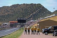 Jul. 21, 2013; Morrison, CO, USA: NHRA safety safari stands for the singing of the national anthem during the Mile High Nationals at Bandimere Speedway. Mandatory Credit: Mark J. Rebilas-