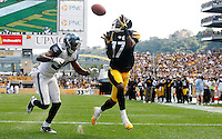 PITTSBURGH - SEPTEMBER 18:  Mike Wallace #17 of the Pittsburgh Steelers catches a touchdown pass in front of Brandon Browner #39 of the Seattle Seahawks in the second half during the game on September 18, 2011 at Heinz Field in Pittsburgh, Pennsylvania.  (Photo by Jared Wickerham/Getty Images)