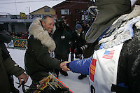 Second place finisher Ed Iten is congratulated by first place Robert Sorlie at the finish line in Nome.   End of the  2005 Iditarod Trail Sled Dog Race.
