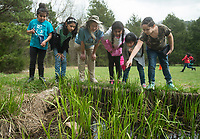 NWA Democrat-Gazette/BEN GOFF @NWABENGOFF<br /> Joanie Patterson (third from left) points out wildlife to 4th graders from Brighton Park school in Chicago Friday, April 13, 2018, at Ozark Natural Science Center near Huntsville. The 4th grade students from Brighton Park, a public charter school, are visiting for a five day immersive environmental education program.