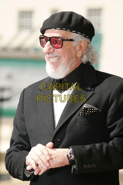 LOU ADLER.Recieves Star on The Hollywood Walk Of Fame, Hollywood, California, USA..April 6th, 2006.Photo: Russ Elliot/AdMedia/Capital Pictures.Ref: RE/ADM.half length sunglasses shades funny face smiling teeth black hat.www.capitalpictures.com.sales@capitalpictures.com.© Capital Pictures.