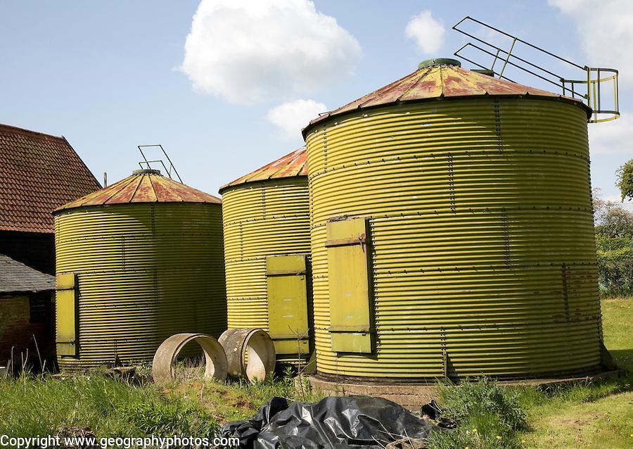 Green sillage storage tanks in farmyard