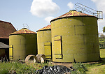 Green sillage storage tanks in farmyard