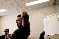 NEW YORK - APRIL 19: Program Coordinator of the show Hard Attack, Jose Mangin, listens during a meeting in a conference room at Sirius Headquarters on April 19, 2005 in New York City. (Photo by Landon Nordeman)