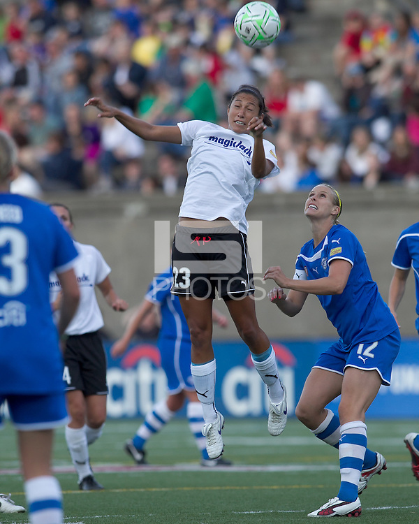 magicJack forward Christen Press (23) heads the ball. In a Women's Professional Soccer (WPS) match, the Boston Breakers defeated magicJack, 2-1, at Harvard Stadium on June 5, 2011.