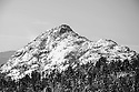 The frozen summit of Mt Chocorua awaits the winter adventurer who musters the will to climb.