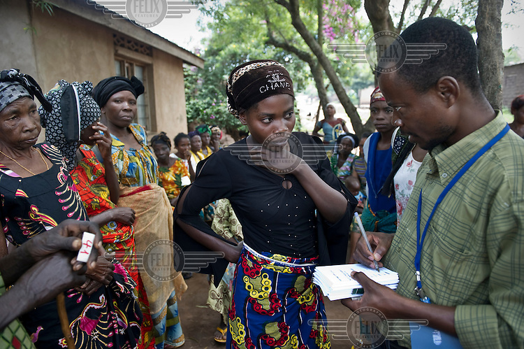 A doctor talks to a woman at a health post in the village of Kashenyi which is supported by a team from Panzi Hospital who come to assist victims of sexual violence. An estimated 250,000 women have been victims of rape during the Democratic Republic of Congo's civil war.