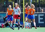 BLOEMENDAAL - Bodine Boelaars (Bldaal) heeft gescoord en viert het met Merel Aarts (Bldaal)  bij Bloemendaal na een doelpunt  tijdens de tweede Play Out wedstrijd hockey dames, Bloemendaal-MOP (5-1)  COPYRIGHT KOEN SUYK