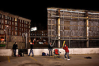 Red Sox fans play baseball in a parking lot outside Fenway Park as they wait overnight to guarantee game-day tickets for the 2011 season opener in Boston, Massachusetts.