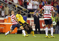 COLUMBUS, OHIO - SEPTEMBER 11, 2012:  Jose Torres (16) of the USA MNT pushes into JeVaughan Watson (15) of  Jamaica during a CONCACAF 2014 World Cup qualifying  match at Crew Stadium, in Columbus, Ohio on September 11. USA won 1-0.