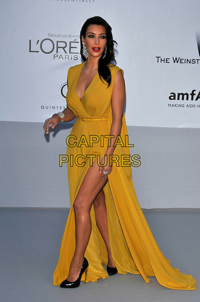Kim Kardashian.AmFAR Cinema Against AIDS 2012, Hotel du Cap, Antibes during the 65th  Cannes Film Festival, France..24th May 2012.full length yellow sleeveless dress slit split    .CAP/PL.©Phil Loftus/Capital Pictures.