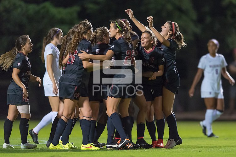 STANFORD, CA - October 3, 2014:  Ryan Walker-Harthorn celebrate's one of her three goals with teammates during the Stanford vs Washington women's soccer match in Stanford, California.  The Cardinal defeated the Huskies 4-1.