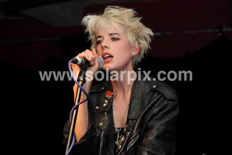 **ALL ROUND PICTURES FROM SOLARPIX.COM**.**WORLDWIDE SYNDICATION RIGHTS**.Agyness Deyn performs with the 5 O'Clock Heros at Industry, Curtain Road, London.  .With the attendance of her friends  Henry Holland, Pixie Geldof, Alexa Chung, Alex Turner and Nick Grimshaw...JOB REF:6630-SSD     DATE:13_06_08.**MUST CREDIT SOLARPIX.COM OR DOUBLE FEE WILL BE CHARGED* *UNDER NO CIRCUMSTANCES IS THIS IMAGE TO BE REPRODUCED FOR ANY ONLINE EDITION WITHOUT PRIOR PERMISSION*
