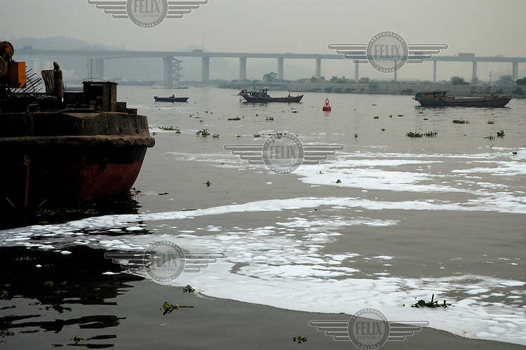 A chemical scum floats in a bay in a branch of the Pearl River.  Such environmental degradation is the result of heavy industry in the area, which is known as 'the world's factory'.