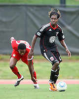 Joseph Ngwenya (11) of D.C. United beats London Woodbury (22)  during a scrimmage against the University of Maryland at Ludwig Field, University of Maryland, College Park, on April  10 2011. D.C. United won 1-0.