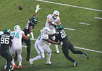 quarterback Ryan Fitzpatrick (14) of the Miami Dolphins unter Druck von defensive tackle Quinnen Williams (95) of the New York Jets - 08.12.2019: New York Jets vs. Miami Dolphins, MetLife Stadium New York