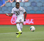 Jomal Williams (20) of Trinidad and Tobago takes a shot on goal against Guyana during their Gold Cup match on June 26, 2019 at Children's Mercy Park in Kansas City, KS.<br /> Tim VIZER/AFP