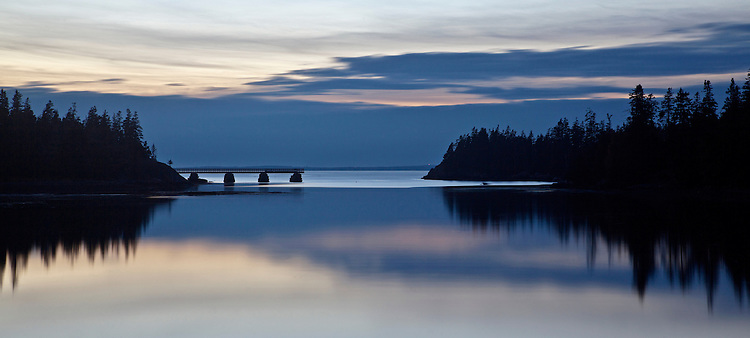 Silhouette of Duck Harbor at dusk on Isle au Haut in Acadia National Park, Maine, USA