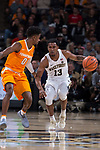 Bryant Crawford (13) of the Wake Forest Demon Deacons tries to dribble past Jordan Bone (0) of the Tennessee Volunteers during first half action at the LJVM Coliseum on December 23, 2017 in Winston-Salem, North Carolina.  The Volunteers defeated the Demon Deacons 79-60.  (Brian Westerholt/Sports On Film)