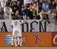CARSON, CA - October 16, 2011: LA Galaxy forward Chad Barrett celebrates his goal with teammate Mike Magee and the fans during the match between LA Galaxy and Chivas USA at the Home Depot Center in Carson, California. Final score LA Galaxy 1, Chivas USA 0.