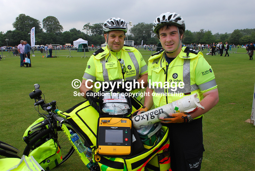 European Pipe Band Championships at Stormont Estate, Belfast, N Ireland, on 30 July 2011. Chris Robinson, Belfast, left, and Glenn Richie, Newtownards, members of St John Ambulance cycle response unit which toured the Stormont Estate during the event. Along with more basic items they were equipped with defibrillators and oxygen supplies. 201107304771...Copyright Image from Victor Patterson, 54 Dorchester Park, Belfast, UK, BT9 6RJ..Tel: +44 28 9066 1296.Mob: +44 7802 353836.Voicemail +44 20 8816 7153.Skype: victorpattersonbelfast.Email: victorpatterson@me.com.Email: victorpatterson@ireland.com (back-up)..IMPORTANT: If you wish to use this image or any other of my images please go to www.victorpatterson.com and click on the Terms & Conditions. Then contact me by email or phone with the reference number(s) of the image(s) concerned.